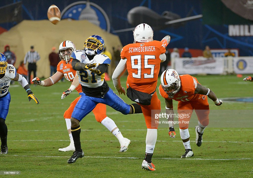 San Jose State defensive back Bene Benwikere (21) blocks a punt by Bowling Green punter Brian Schmiedebusch (95) during 3rd quarter action resulting in a safety on December 27, 2012 in Washington, DC
