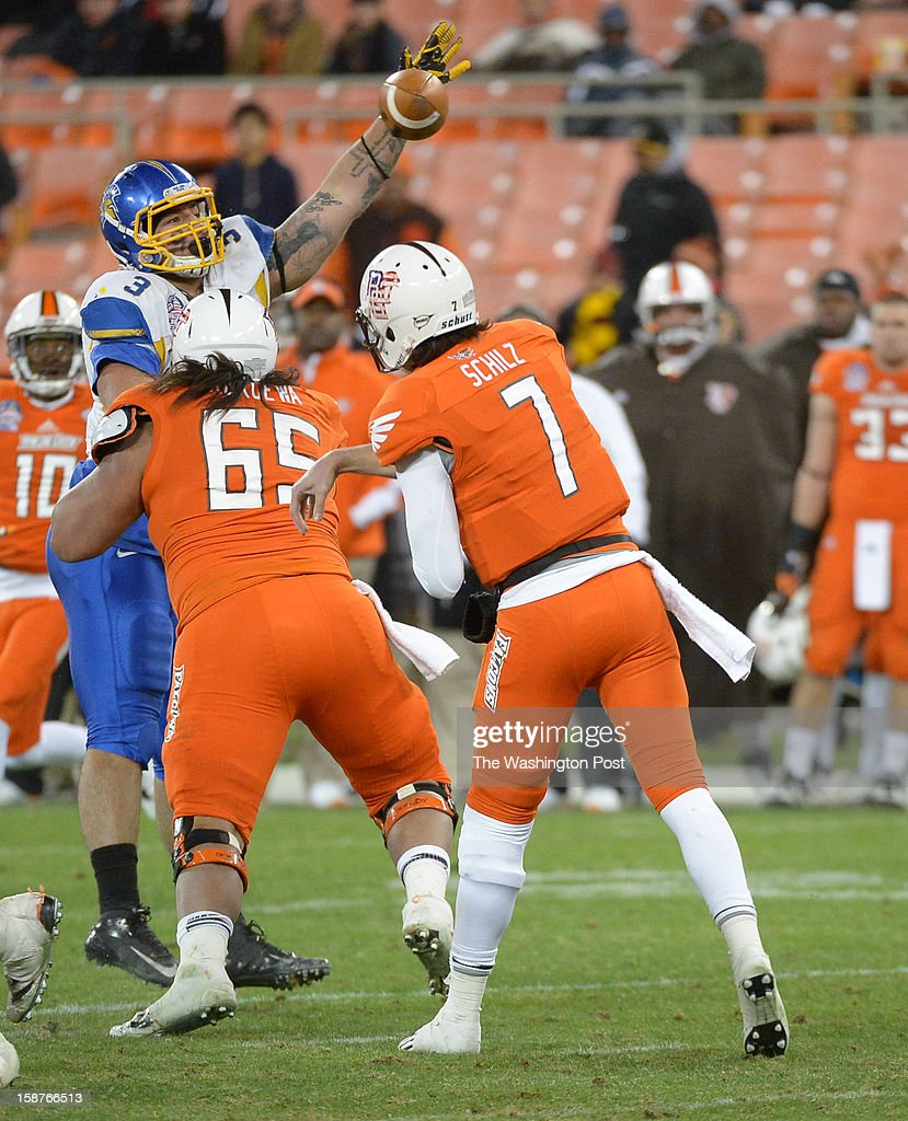 San Jose State defensive tackle Travis Raciti (3) bats the ball down as Bowling Green quarterback Matt Schilz (7) throws the ball on 4th down during 4th quarter action on December 27, 2012 in Washington, DC