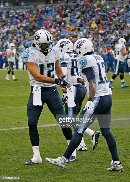 Charlie Whitehurst Tennessee Titans quarterback congratulates Kendall Wright Tennessee Titans wide receiver after touchdown during the game between...