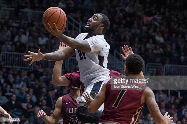 Butler University guard Roosevelt Jones drives by IUPUI Jaguars guard TJ Henderson for a layup during the NCAA basketball game between the Butler...