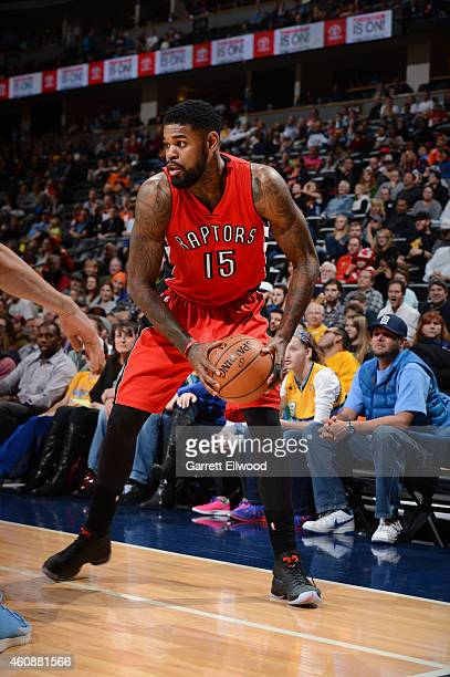 Amir Johnson of the Toronto Raptors defends the ball against the Denver Nuggets during the game on December 28 2014 at Pepsi Center in Denver...