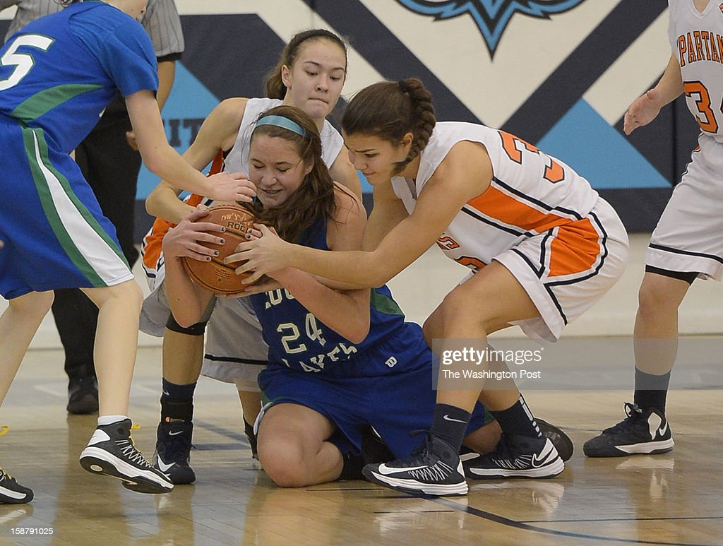 South Lakes C Abigail Rendle (24) dives on the floor for a loose ball against West Springfield in the IAABO Holiday Classic final on December 28, 2012 in Largo, MD
