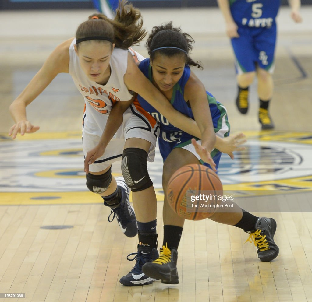 West Springfield G Shelby Haynes (21) (L) battles South Lakes G Sasha Sprei (4) for a loose ball in the IAABO Holiday Classic final on December 28, 2012 in Largo, MD