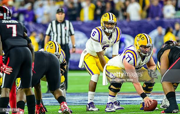LSU Tigers quarterback Brandon Harris eyes the defense as LSU Tigers center Ethan Pocic prepares to snap the ball during the 2015 Advocare Texas Bowl...