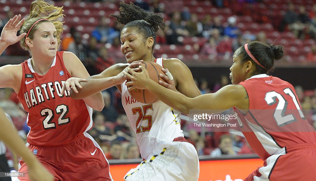 Maryland Terrapins forward Alyssa Thomas (25) battles for a loose ball against Hartford Hawks forward Katie Roth (22) and guard Shanise Bultron (21) during 2nd half action on December 29, 2012 in College Park, MD