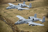 December 30, 2013 - Two A-10 Thunderbolt II's conduct a training mission over Razorback Range at Fort Chaffee Maneuver Training Center, Arkansas.