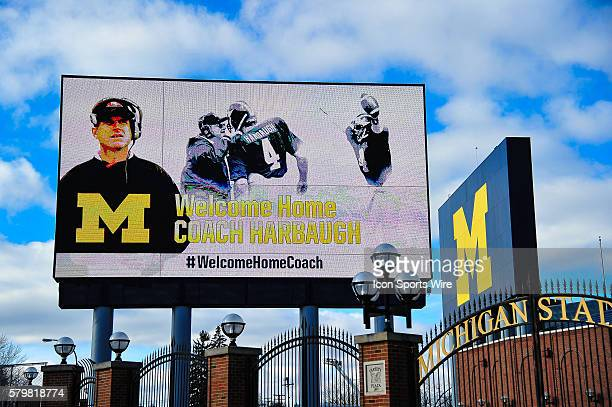 The billboard outside of Michigan Stadium welcomes home New Football Head Coach Jim Harbaugh during the press conference at the Junge Familly...