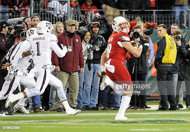 Louisville Cardinals tight end Cole Hikutini catches a 54 yd pass to set up Louisville Cardinals first touchdown during an college football game...