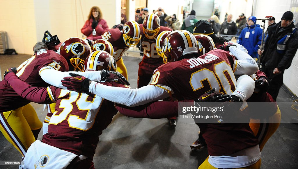 Redskins players form a circle in the tunnel before taking the field as the Washington Redskins play the Dallas Cowboys at FedEx field on December 30, 2012 in Landover, MD