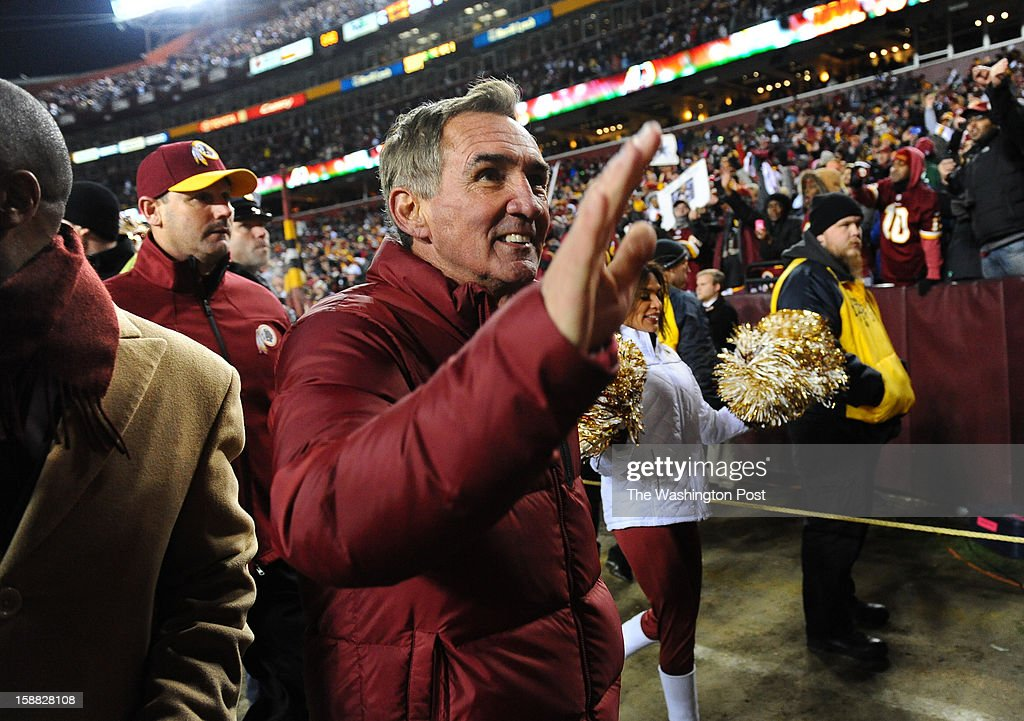 Washington Redskins head coach Mike Shanahan waves to the fans following their 28-18 win over the Dallas Cowboys at FedEx field on December 30, 2012 in Landover, MD