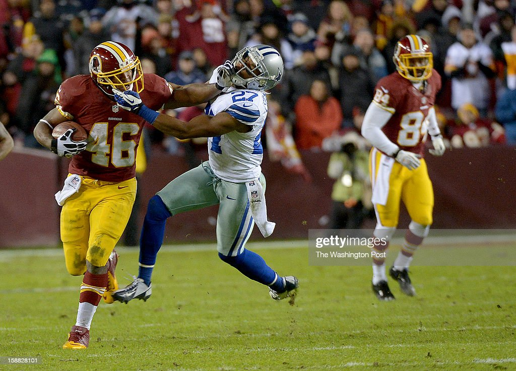 Washington Redskins running back Alfred Morris (46) stiff arms Dallas Cowboys strong safety Eric Frampton (27) on his way for a big 3rd quarter gain at FedEx field on December 30, 2012 in Landover, MD