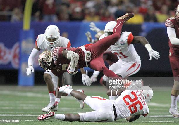 Florida State Seminoles wide receiver Jesus Wilson is upended by Houston Cougars cornerback Brandon Wilson during the ChickfilA Peach Bowl between...