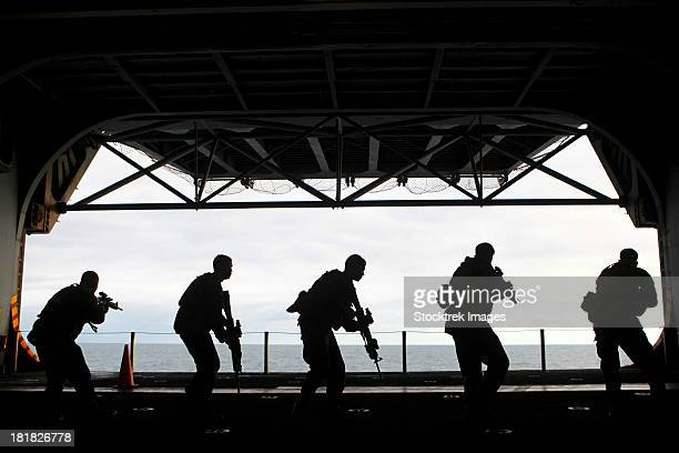 December 6, 2011 - Marines conduct rifle movement drills during sustainment training aboard the USS Iwo Jima.
