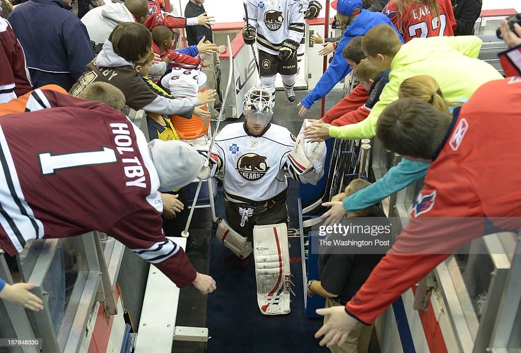 Fans greet Hershey Bears G Braden Holtby as he comes off the ice after warm-ups prior to AHL action against the Norfolk Admirals on December 6, 2012 in Washington, DC
