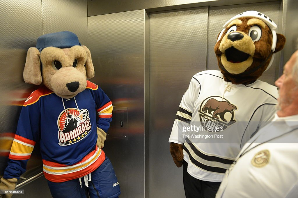 Salty the Norfolk Admirals mascot (left) and the Coco of the Hershey Bears keep their distance while riding the elevator in between innings on December 6, 2012 in Washington, DC