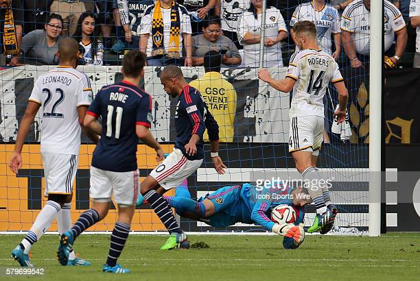 Los Angeles Galaxy's Jaime Penedo makes the save on New England Revolution's Teal Bunbury The Los Angeles Galaxy defeated the New England Revolution...