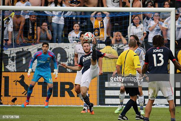 New England Revolution's Patrick Mullins tries a bicycle kick in front of Los Angeles Galaxy's Jaime Penedo The Los Angeles Galaxy defeated the New...