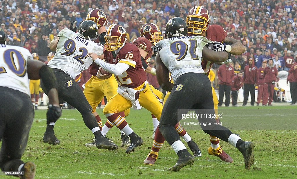 Washington Redskins quarterback Kirk Cousins (12) breaks for the endzone to score on a two point conversion to tie the game at 28 forcing overtime against the Baltimore Ravens at FedEx Field on December 9, 2012 in Landover, MD