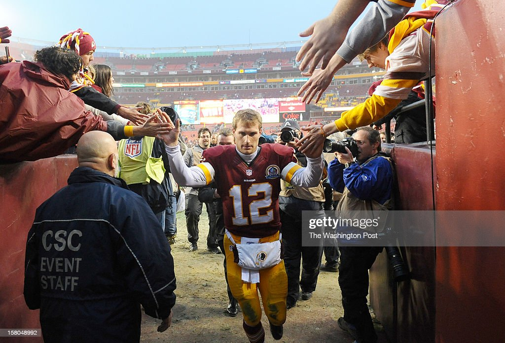 Washington Redskins quarterback Kirk Cousins (12) leaves the field following their 31-28 overtime victory over the Baltimore Ravens at FedEx Field on December 9, 2012 in Landover, MD