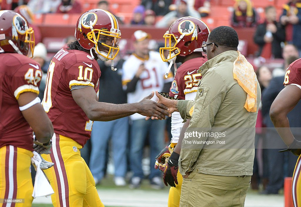 Washington Redskins quarterback Robert Griffin III (10) is greeted by former RB Clinton Portis prior to game action against the Baltimore Ravens at FedEx Field on December 9, 2012 in Landover, MD