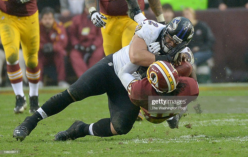 Washington Redskins quarterback Robert Griffin III (10) is injured when he is hit by Baltimore Ravens defensive end Haloti Ngata (92) during 4th quarter action at FedEx Field on December 9, 2012 in Landover, MD