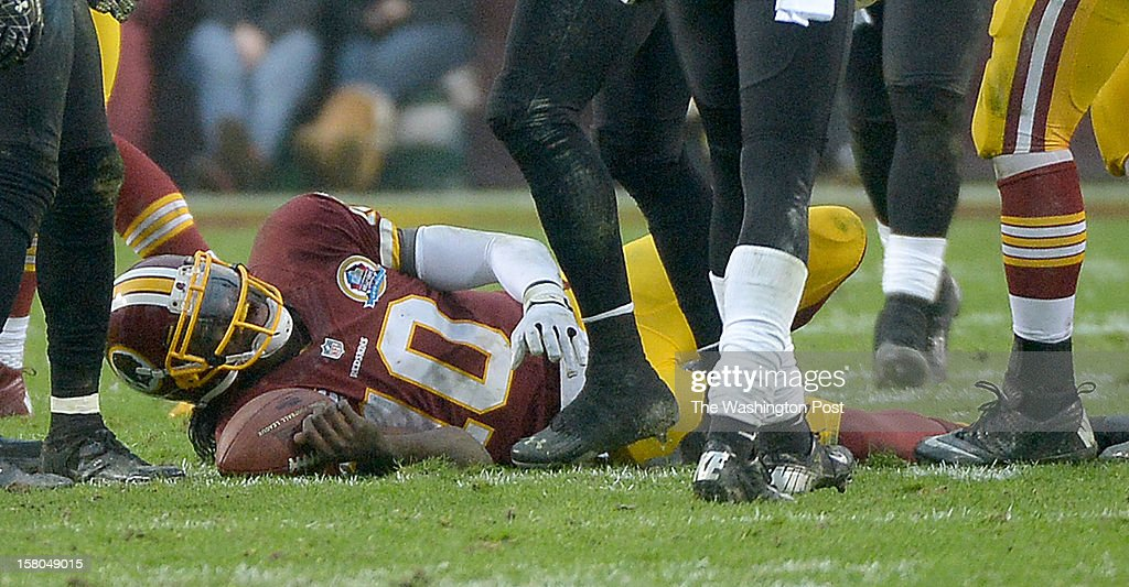 Washington Redskins quarterback Robert Griffin III (10) is injured after being hit by Baltimore Ravens defensive end Haloti Ngata (92) during 4th quarter action at FedEx Field on December 9, 2012 in Landover, MD
