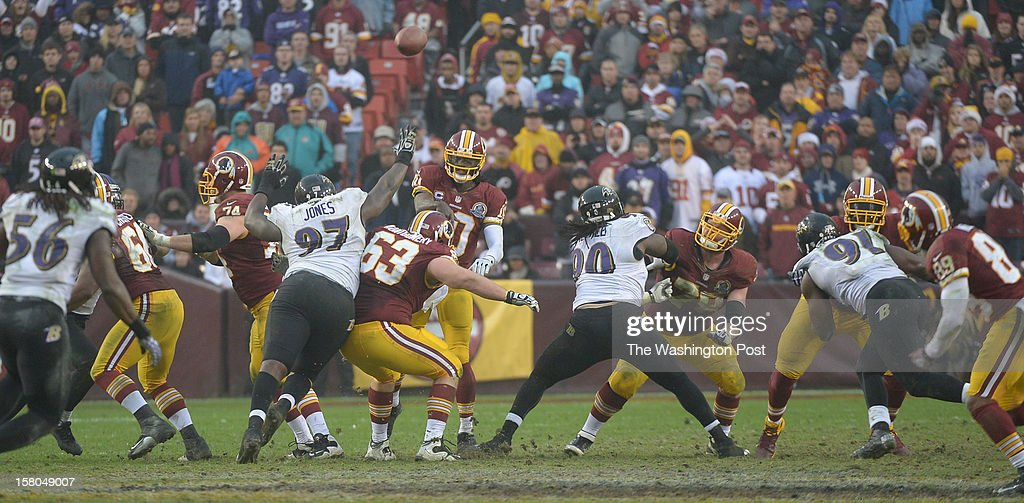 Washington Redskins quarterback Robert Griffin III (10) makes a completion to wide receiver Santana Moss (89) after he came back in after being injured during 4th quarter action at FedEx Field on December 9, 2012 in Landover, MD