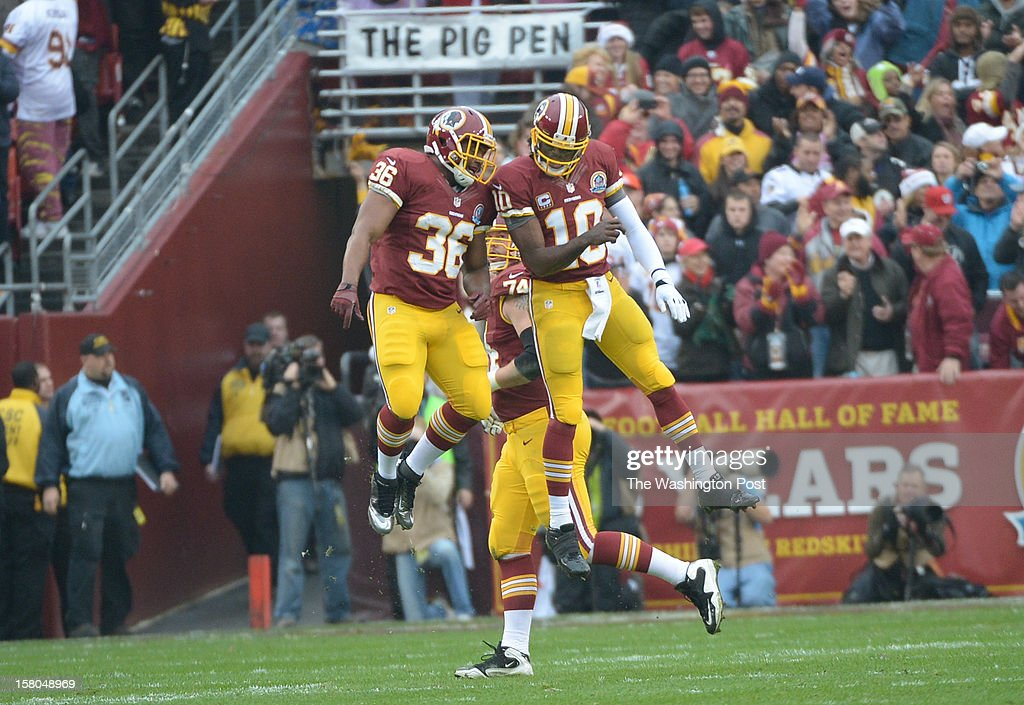 Washington Redskins quarterback Robert Griffin III (10) celebrates with Washington Redskins fullback Darrel Young (36) after Griffin's first-quarter touchdown pass against the Baltimore Ravens at FedEx Field on December 9, 2012 in Landover, MD