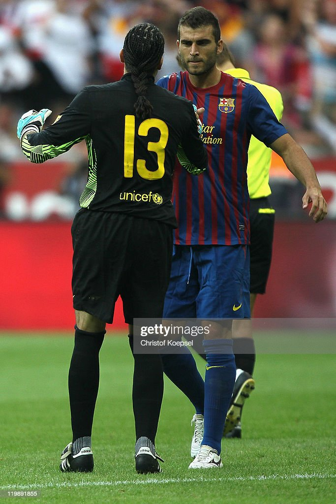 Deciding penalty-scorer Armando Lozano (L) and goalkeeper <a gi-track='captionPersonalityLinkClicked' href=/galleries/search?phrase=Jose+Manuel+Pinto&family=editorial&specificpeople=708358 ng-click='$event.stopPropagation()'>Jose Manuel Pinto</a> of Barcelona celebrate after the penalty shoot out at the close of the Audi Cup match between FC Barcelona and International de Porto Alegre at Allianz Arena on July 26, 2011 in Munich, Germany.