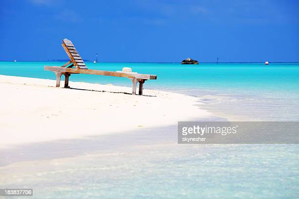 Deck chair on the beach.