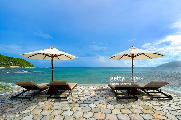 Deck chairs and parasols await holidaymakers in the Mandarin Oriental hotel resort on the Dadonghai bay coast of Sanya on August 15 2010 in Hainan...