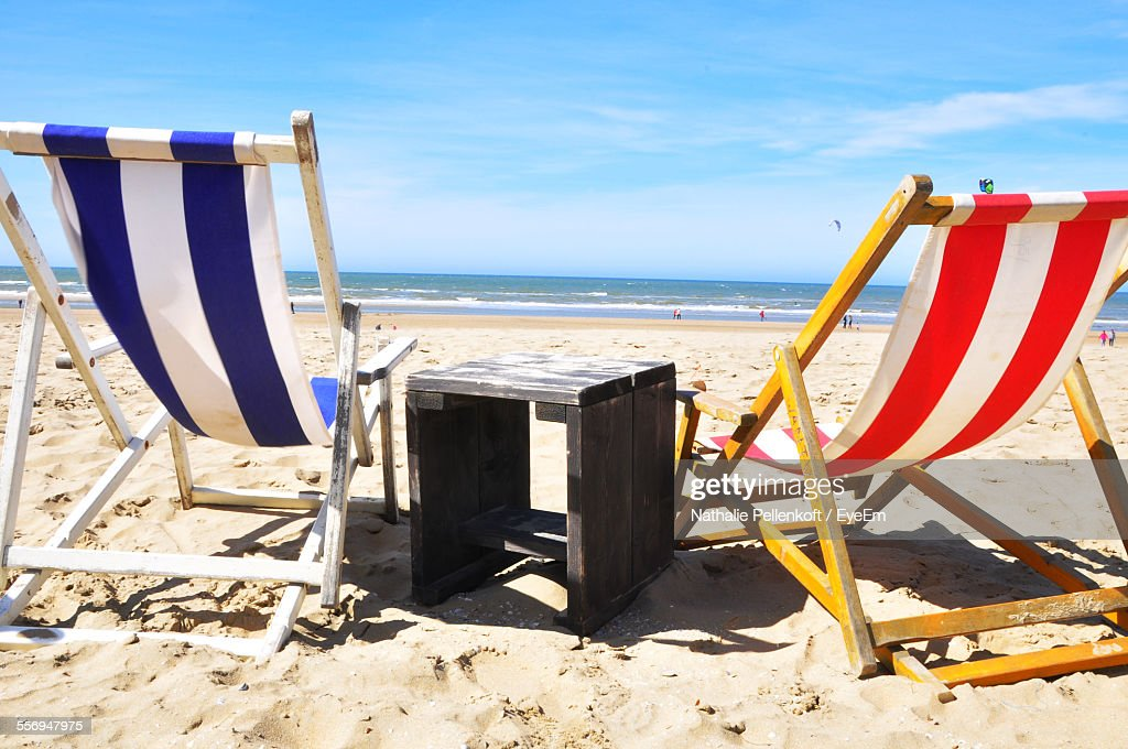 Deck Chairs And Table On Beach : Stock Photo
