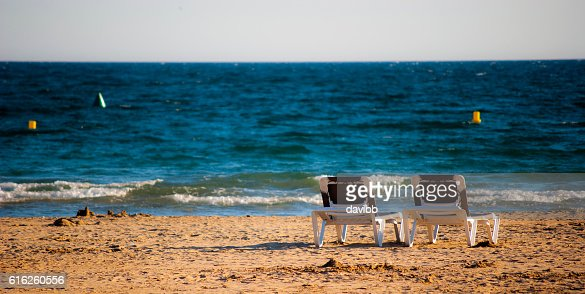Deck chairs at the beach : Stock Photo