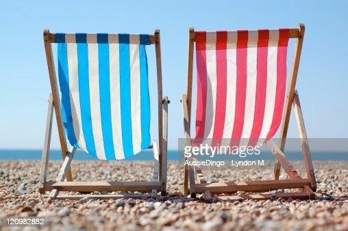 Deck chairs on Brighton beach, English Seaside