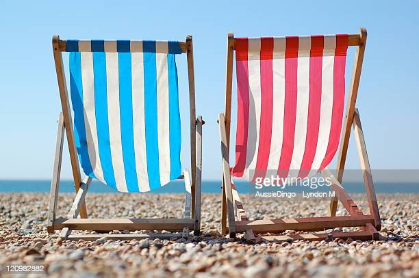 Deck chairs on Brighton beach, English Seaside