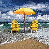 Deckchair and beach umbrella on coast