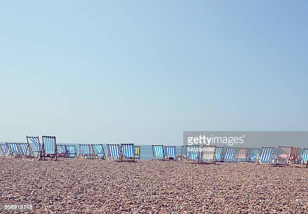 Deckchairs in a row on Brighton Beach, UK