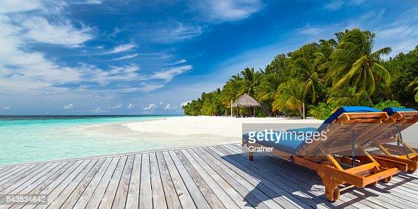 deckchairs on jetty : Stock Photo