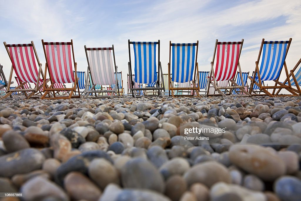 Deckchairs on Pebble Beach, Sidmouth, Devon, UK : Stock Photo