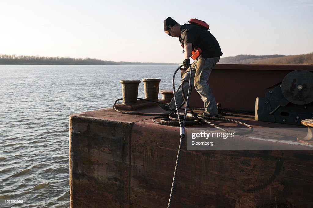 Deckhand Colin Simmons works on a barge on the Mississippi River at Knight Hawk Coal LLC in Chester, Illinois, U.S., on Friday, Nov. 30, 2012. The family-owned Knight Hawk employs 400 people and has another 300 contractors, including about 140 truck drivers. The company has never had layoffs since it opened in 1998, said Andrew Carter, vice president of sales and distribution. A blocked Mississippi could change that. Photographer: Whitney Curtis/Bloomberg via Getty Images