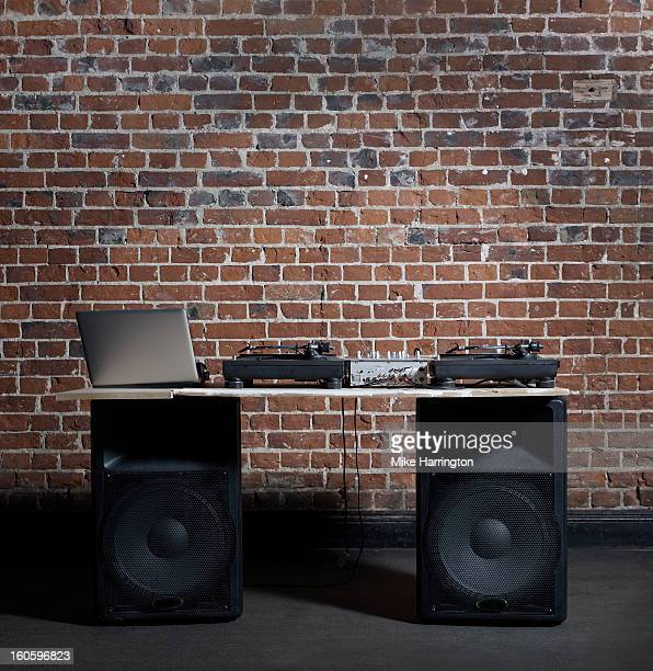 DJ Decks and Laptop in Front of Brick Wall