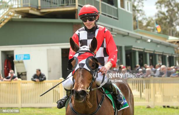 Declan Bates returns to the mounting yard on Normandy Lad after winning McConnell Dowell Martinus Rail BM52 Handicapat Avoca Racecourse on October 21...