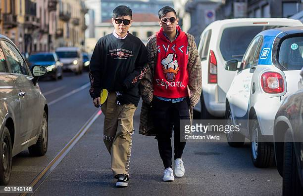 Declan Chan wearing a black sweater brown pants Vans and Bryan Boy wearing a Gucci Donald Duck hoody checked coat black pants white sneaker at No 21...