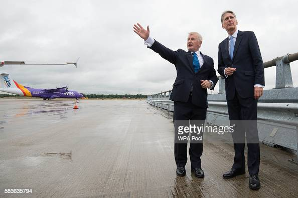 Declan Collier CEO of London City Airport and Chancellor Phillip Hammond during a visit to London City Airport on July 27 2016 in Lodnon England...