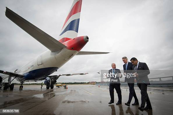Declan Collier CEO of London City Airport Chancellor Phillip Hammond and Minister for Aviation Lord Ahmad during a visit to London City Airport on...