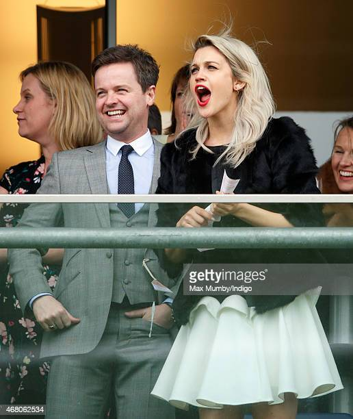 Declan Donnelly and Ashley Roberts watch the racing as they attend The Prince's Countryside Fund Raceday at Ascot Racecourse on March 29 2015 in...