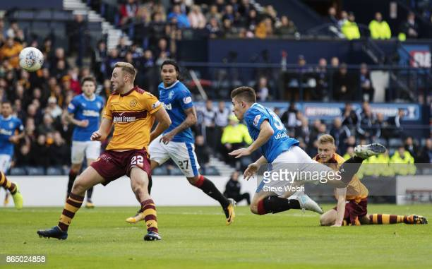 Declan John of Rangers has a fine header pushed away by the Motherwell keeper during the Betfred Cup Semi Final at Hampden Park on October 22 2017 in...