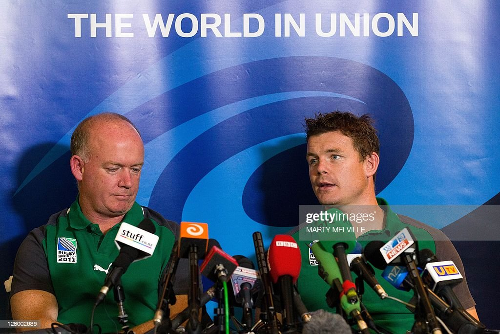 Declan Kidney, the head coach of Ireland speaks to the media with captain Brian O'Driscoll (R) during a team announcement, three days out from their 2011 Rugby World Cup quarter final against Wales, at a hotel in Wellington on October 5, 2011. AFP PHOTO / Marty Melville
