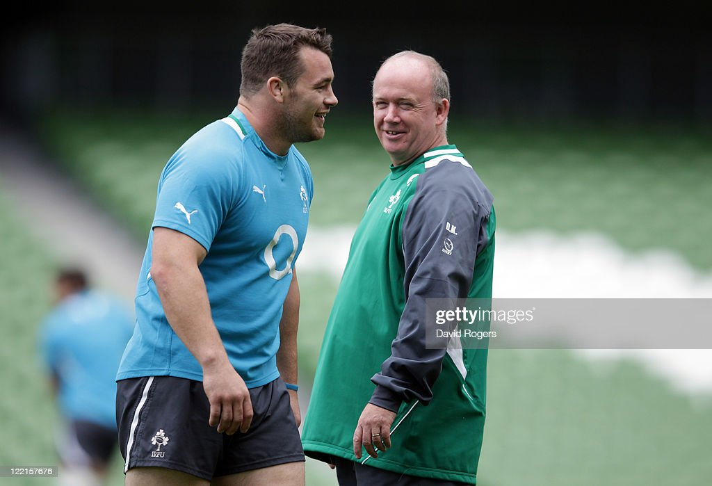 <a gi-track='captionPersonalityLinkClicked' href=/galleries/search?phrase=Declan+Kidney&family=editorial&specificpeople=626890 ng-click='$event.stopPropagation()'>Declan Kidney</a>,(R) the Ireland coach smiles with Ireland prop <a gi-track='captionPersonalityLinkClicked' href=/galleries/search?phrase=Cian+Healy&family=editorial&specificpeople=4166531 ng-click='$event.stopPropagation()'>Cian Healy</a> during the Ireland captain's run held at the Aviva Stadium on August 26, 2011 in Dublin, Ireland.