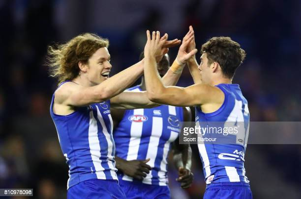 Declan Mountford of the Kangaroos is congratulated by Ben Brown of the Kangaroos after kicking his first goal during the round 16 AFL match between...